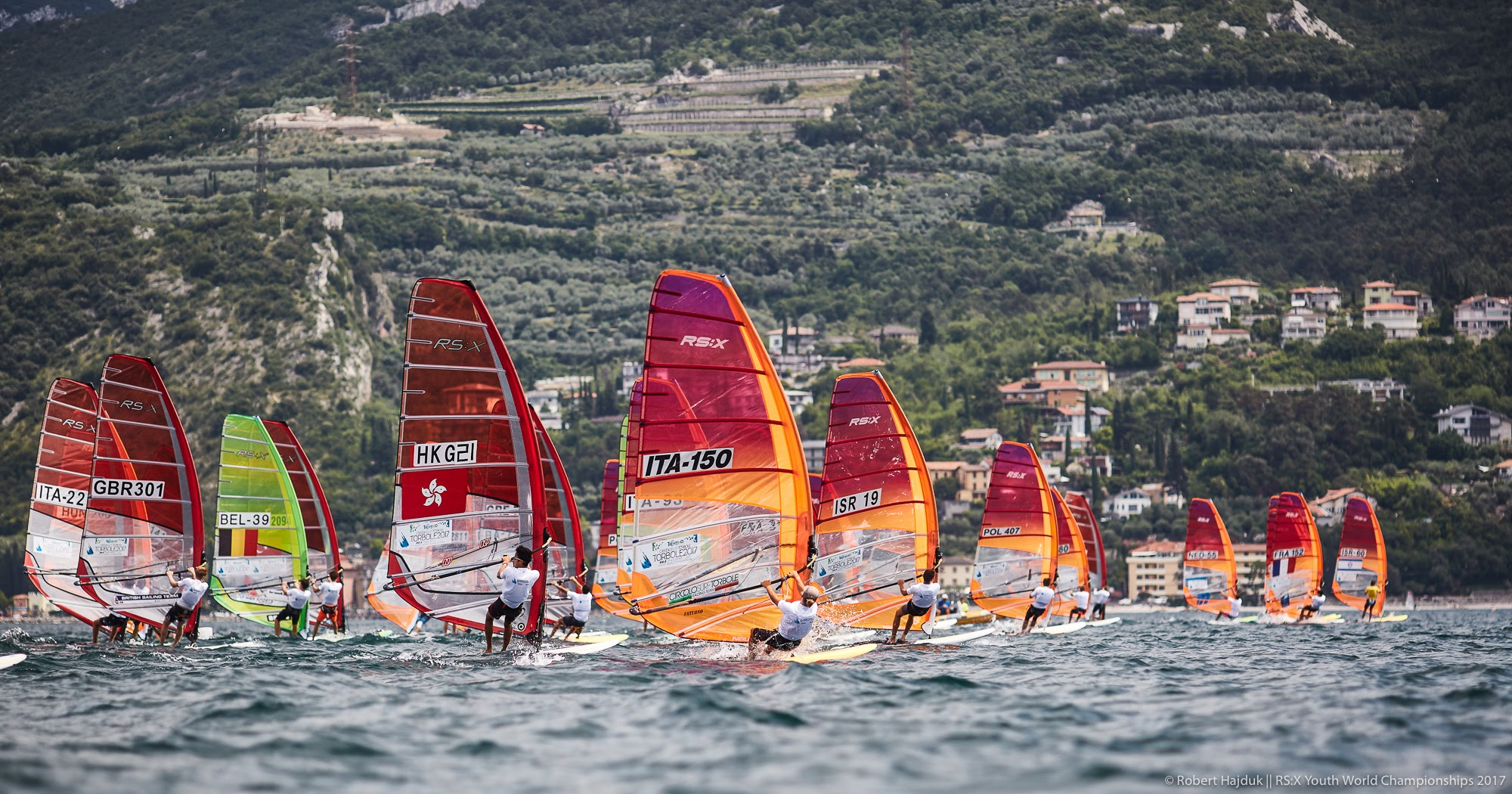2017 RS:X Youth World Championships || 2017-06-28, Torbole, Lake Garda, Italy || © Copyright 2017 || RS:X Class: Robert Hajduk - ShutterSail.com || All Rights Reserved || srcset=